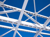 Steel beams against the blue sky — Stock Photo