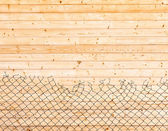 Wooden background. Wall paneling and mesh netting — Stock Photo