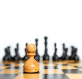 Chess. White pawn against black pieces — Stock Photo