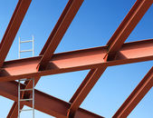 Steel beams and ladder against the blue sky. Fragment constructi — Stock Photo