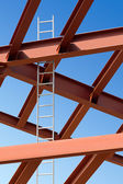 Steel beams and ladder against the blue sky — Stock Photo