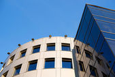 Fragment of the building against the blue sky — Stock Photo
