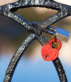 Red lock in the shape of a heart — Stock Photo