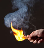 Burning match in hand. Smoke — Stock Photo