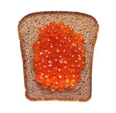 Sandwich with red caviar on white background — Stock Photo