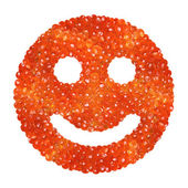Red caviar in the form of a smile on a white background — Stock Photo