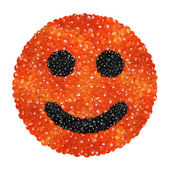 Red and black caviar in the form of a smiling face on a white ba — Stock Photo