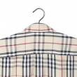 Foto de Stock  : Men shirt on hanger