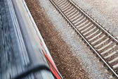Railway tracks and the rushing train — Stock Photo