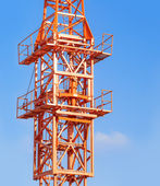 Fragment modern industrial construction against the blue sky — Stock Photo