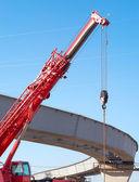 Hoisting crane, construction of overhead road — Stock Photo