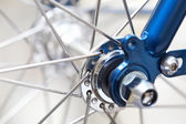 Fragment of a bicycle wheel with shallow depth of field — Stock Photo