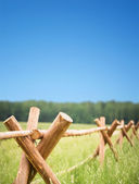 Wooden fence in field encloses farmer economy — Stock Photo