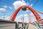 Red metal arch over the highway. Zhivopisny bridge. Moscow. Russ — Stock Photo