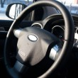 Black automobile steering with airbag — Stock Photo