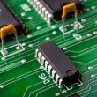 Macro silicon chip on green board — Stock Photo