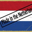 Vintage label with the flag of Netherlands — Stock Vector