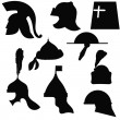 A set of silhouettes of medieval military helmets — Stock Vector
