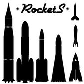 Set of silhouettes of rockets — Stock Vector
