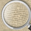 Magnifying glass and old sheet of paper with text — Imagen vectorial
