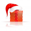 Santa Claus hat on the present — Stock Vector