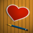 Lacy red heart on a wooden background and pencil — Stock Photo #38449709