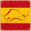 Grunge Spanish flag with the silhouette of a bull — Stock Photo