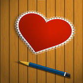 Lacy red heart on a wooden background and pencil — Stock Photo
