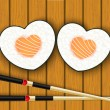 Heart-shaped sushi and chopsticks — 图库矢量图片
