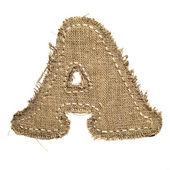 письмо, вырезанный из льняной ткани — Стоковое фото