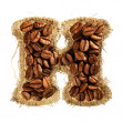 Alphabet from coffee beans on fabric texture isolated on white - 图库照片