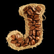 Alphabet from coffee beans on fabric texture isolated on black - Foto de Stock