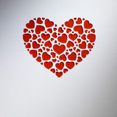 Valentine day heart made of small hearts on paper card — Stock Photo