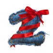 Royalty-Free Stock Photo: Jeans alphabet digit with holiday red ribbon