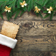 Stock Photo: Christmas fir tree with decoration on a wooden board