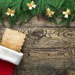 Christmas fir tree with decoration on a wooden board — Stock Photo #21806935