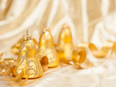 Christmas background of defocused golden lights. — Stock Photo