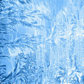 Frosty pattern on window in winter season — Stock Photo