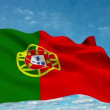 Portugal flag waving against time-lapse clouds background - Stock Photo
