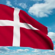 Denmark flag waving against time-lapse clouds background - 图库照片