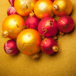 Stock Photo: Christmas background of defocused golden lights