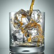Pouring Scotch Whisky in Glass with perfect ice - Stock Photo
