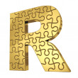 Stock Photo: 3d rendering of the puzzle letter in gold metal on a white isola