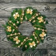 Christmas wreath over old wood background - Stock Photo
