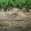 Christmas fir tree with decoration on a wooden board — Stock Photo