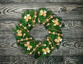Christmas wreath over old wood background — Foto de Stock