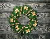 Christmas wreath over old wood background — Zdjęcie stockowe