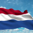 Holland flag waving against time-lapse clouds background — Stock Video