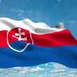Slovak flag waving against time-lapse clouds background - Stock Photo