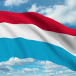 Luxembourg flag waving against time-lapse clouds background - Stock Photo